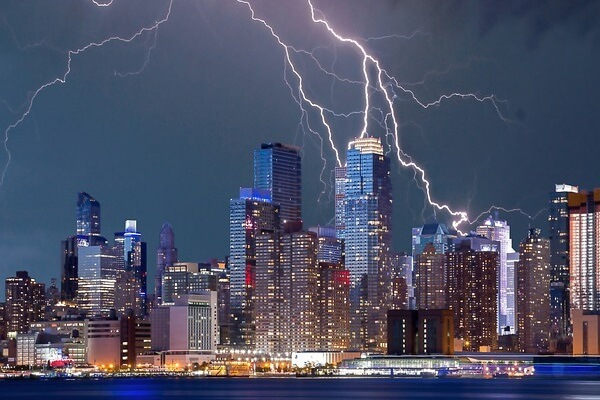 Lightning crackles above a city, the perfect time to have a UPS in storm season